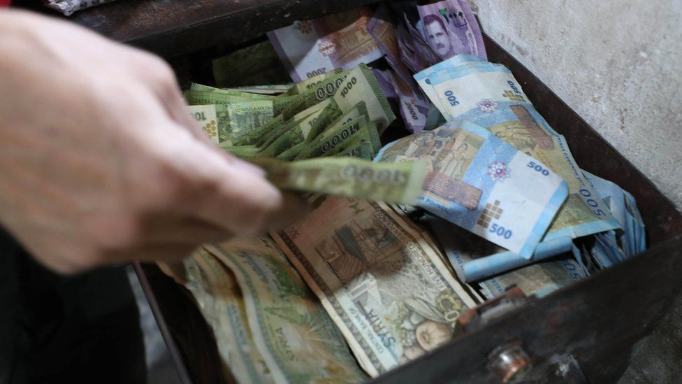 Syrian pounds in a cash register in the rebel-held town of Binnish, Syria (9 June 2020)