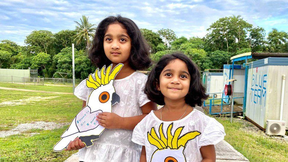 Kopika (left) and her sister Tharnicaa on Christmas Island in 2020