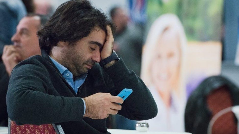 A National Front supporter reacts to first election results in Marseille. Photo: 13 December 2015