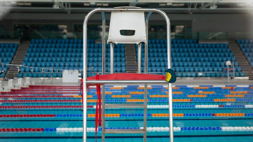 An empty lifeguard chair at the empty Cardiff International swimming pool
