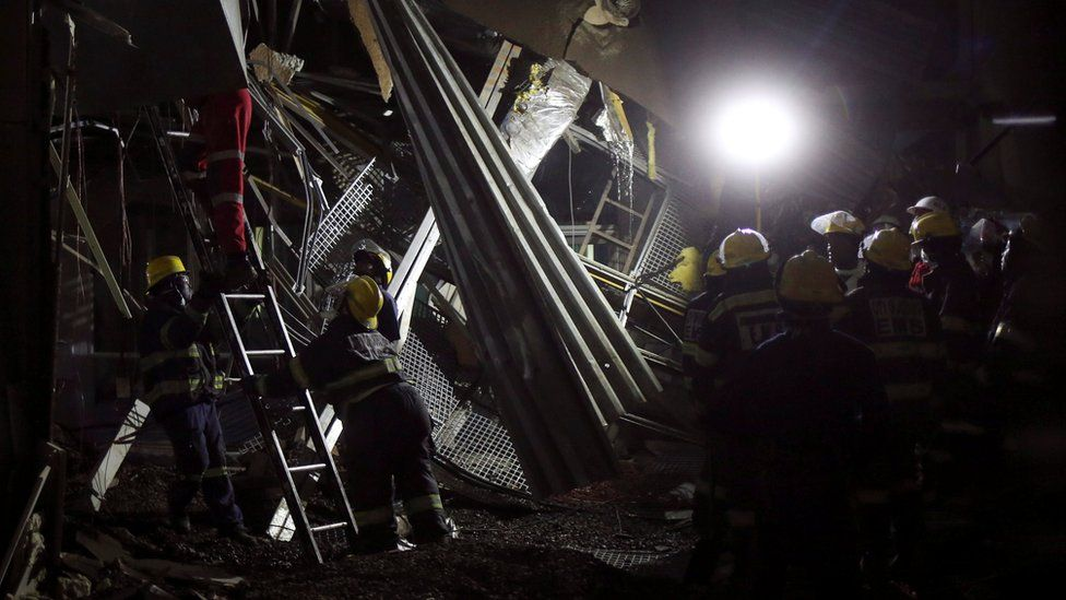 Rescue workers are seen at a site of a roof collapse at Johannesburg's Charlotte Maxeke state hospital in Johannesburg