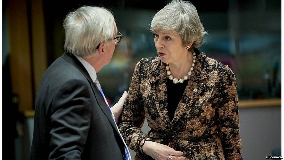 Theresa May speaking to European Commission president Jean-Claude Juncker