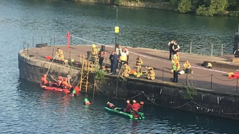 Police and rescue services search for the missing man at Shadwell Basin, Wapping