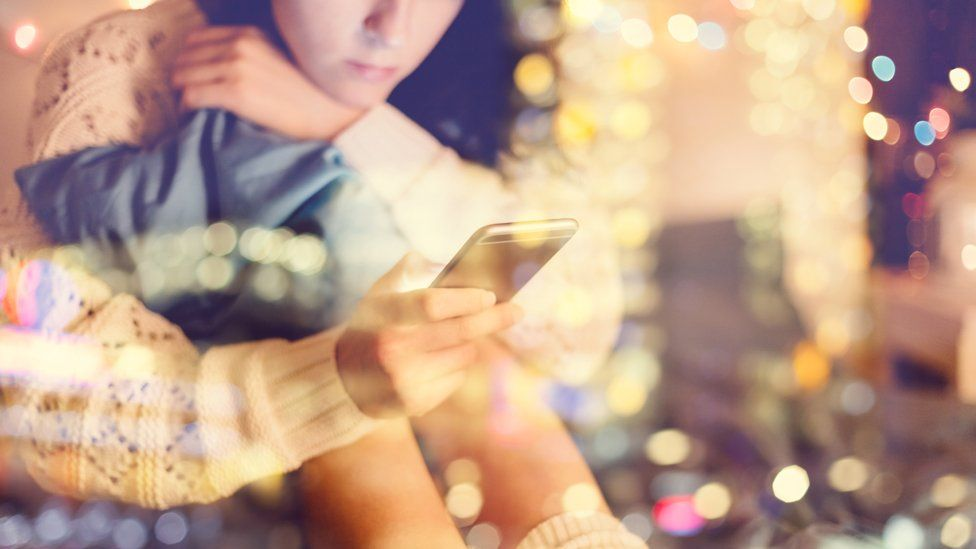 Girl looking at mobile phone