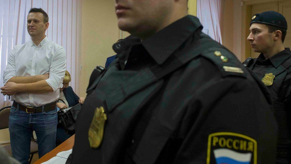 Russian opposition politician and anti-corruption campaigner Alexei Navalny attends the verdict in his trial for embezzlement at the Leninsky Court in the city of Kirov