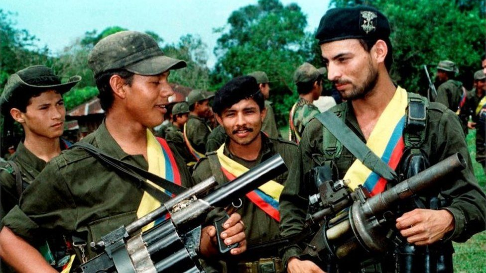 Farc guerrilla fighters pose with their weapons after a patrol in the jungle near the town of Miraflores, Colombia, August 7, 1998
