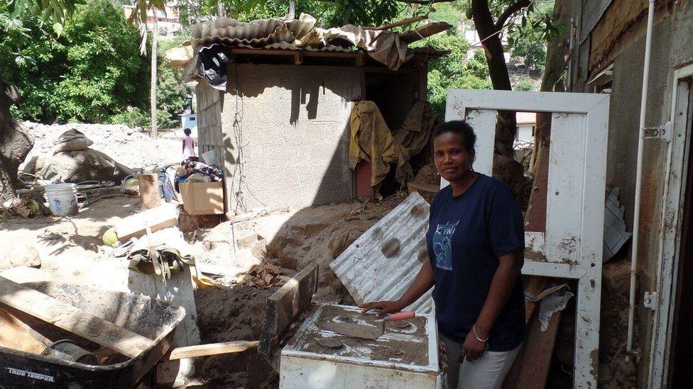 Molly John stands outside her ruined restaurant in September 2015