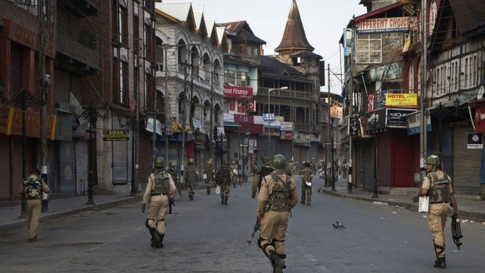 Indian paramilitary soldiers patrol a deserted street during curfew in Srinagar, Indian controlled Kashmir, Tuesday, Sept. 13, 2016.