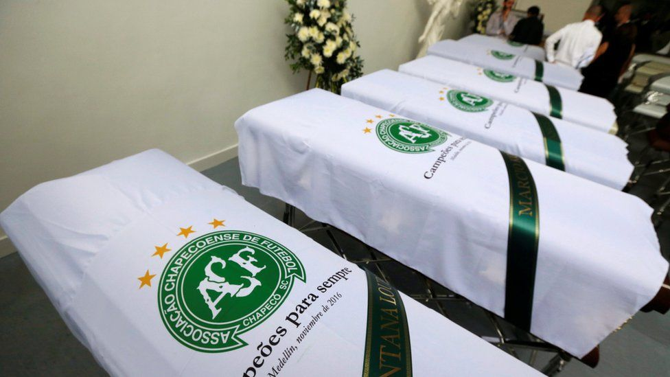 Blankets bearing the crest of Brazilian soccer team Chapecoense are placed on coffins in Medellin, Colombia December 1, 2016.