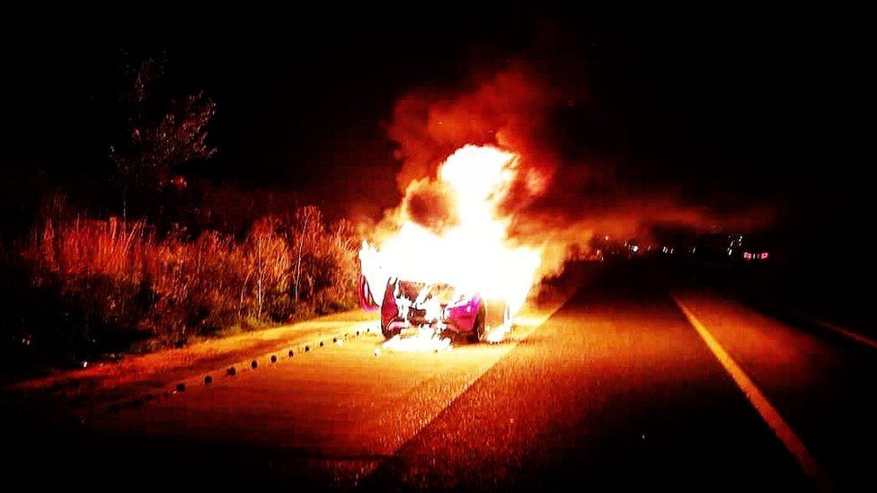 George Roberts' car on fire