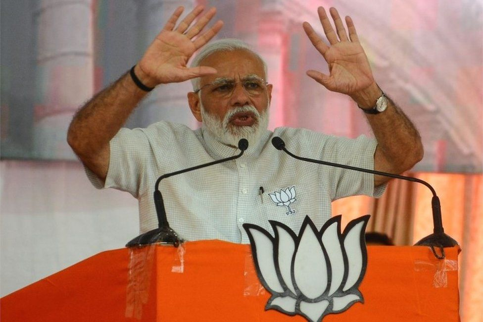 Indian Prime Minister Narendra Modi gestures during a rally in Amreli, some 250km from Ahmedabad, on April 18, 2019