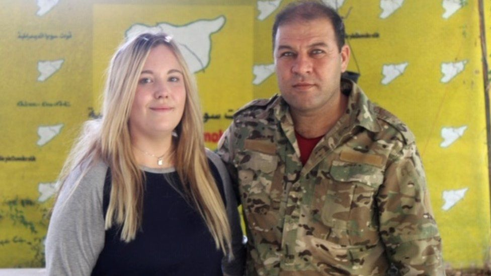 Bethany Haines and YPG officer