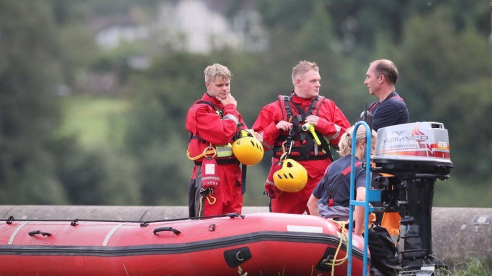 Rescuers and a boat