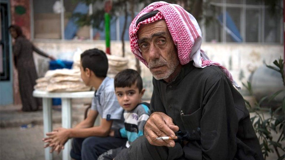 Displaced Syrian man and children in Hasakeh, north-east Syria (24/10/19)