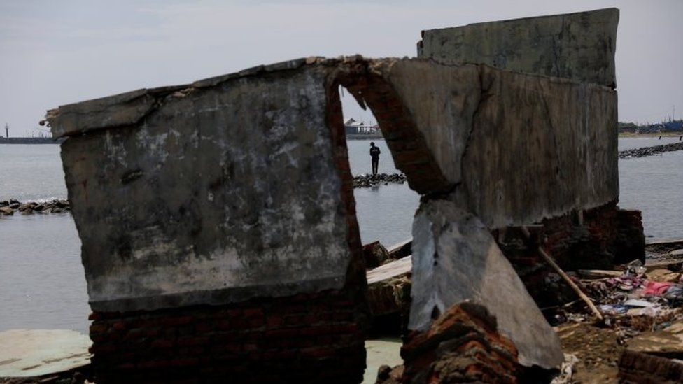 Shoreline debris seen in Indonesia after flooding