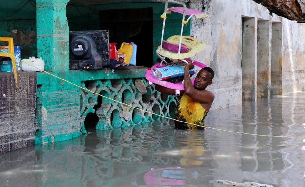 A resident evacuates furniture after rain water flooded his home in Mogadishu, Somalia May 21, 2018