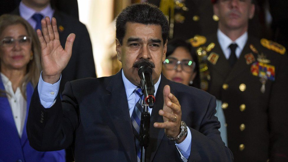 Venezuelan President Nicolas Maduro speaks outside the Presidential Palace in Caracas