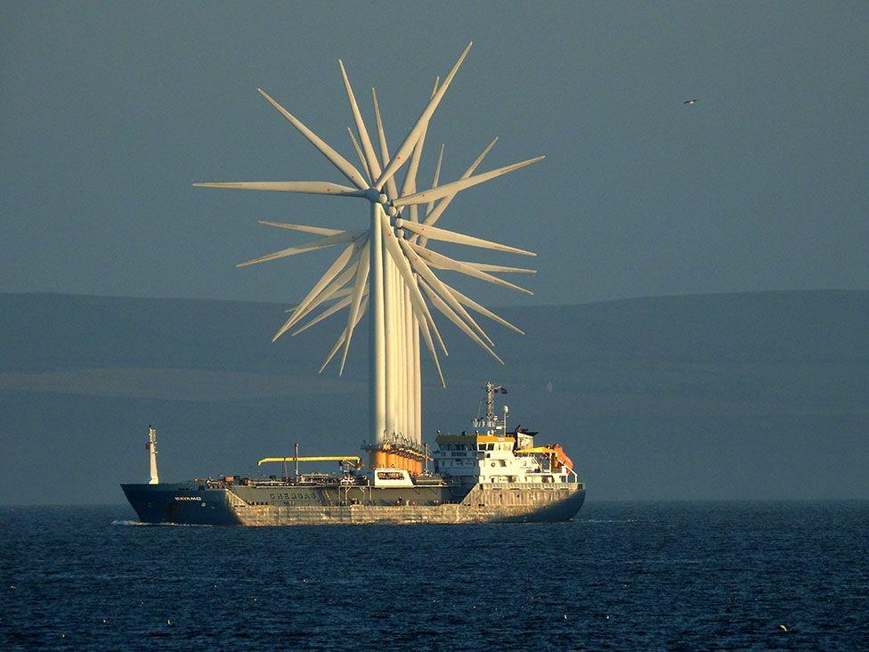 Sea wind turbines seen in a line