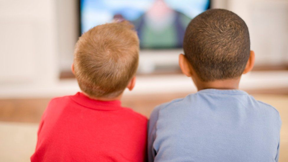 Two boys watching television
