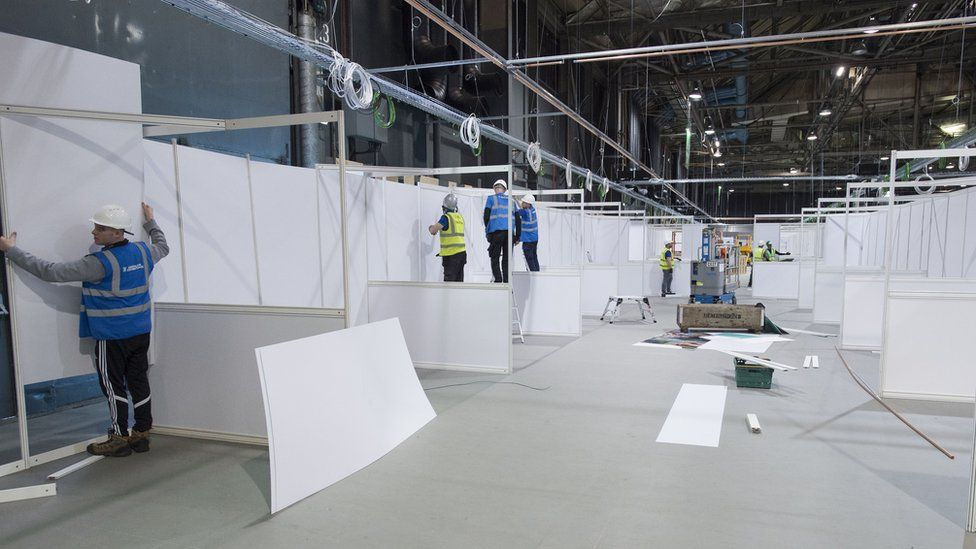 Workers building the interior of the new temporary NHS Louisa Jordan Hospital at the SEC event centre on April 07, 2020 in Glasgow, Scotland.