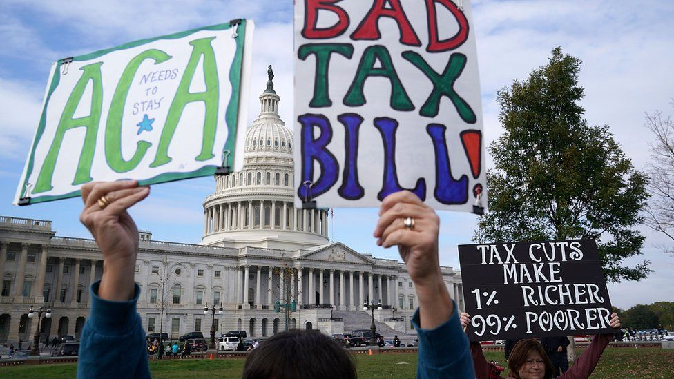 Demonstrators join a rally against the proposed Republican tax reform legislation on the east side of the U.S. Capitol November 15, 2017 in Washington, DC.