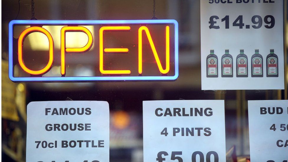 Price tags announcing special prices are displayed at a liquor store in Glasgow