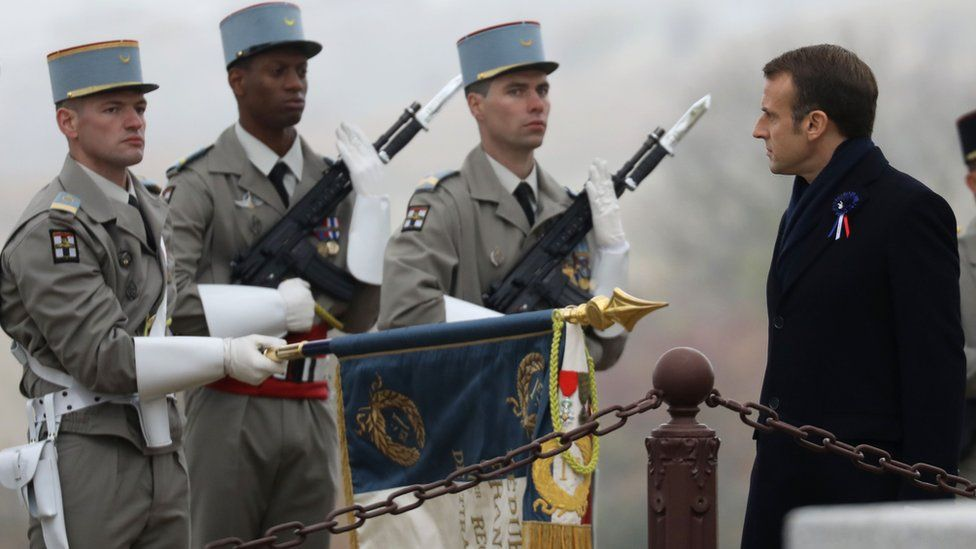 French President Emmanuel Macron reviews a military honour guard as he attends a ceremony in tribute to the French soldiers killed in August 1914 during border battles, at the monument in Morhange, eastern France, on November 5, 2018