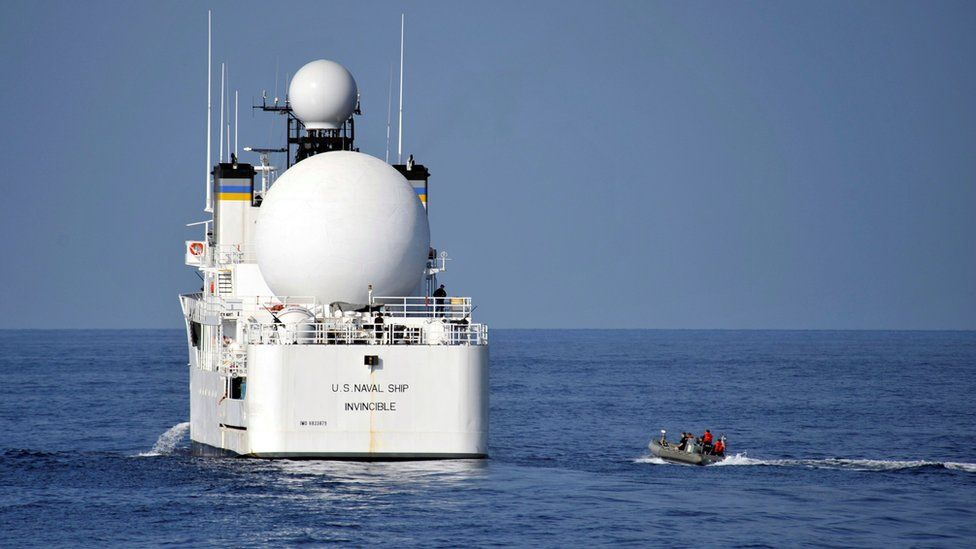U.S. sailors in a rigid-hull inflatable boat approach the Military Sealift Command missile range instrumentation ship USNS Invincible (L) to conduct a personnel transfer in Arabian Sea on November 21, 2012.