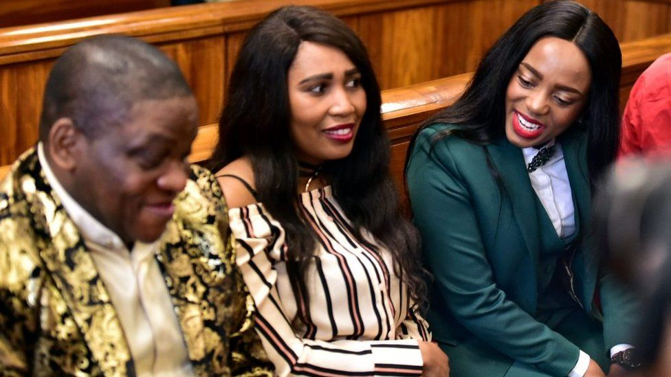 Controversial Nigerian pastor Timothy Omotoso and his co-accused Lusanda Sulani (36) and Zukiswa Sitho (28) during their appearance on charges of rape and human trafficking at the Port Elizabeth High Court on October 08, 2018 in Nelson Mandela Bay, South Africa