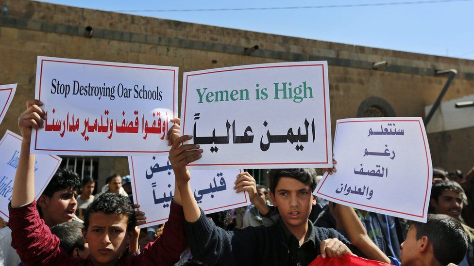 Young Yemenis hold placards during a protest against ongoing Saudi-led coalition military operations in the country, in front of the Russian embassy in Sana'a, Yemen, 03 December 2015.