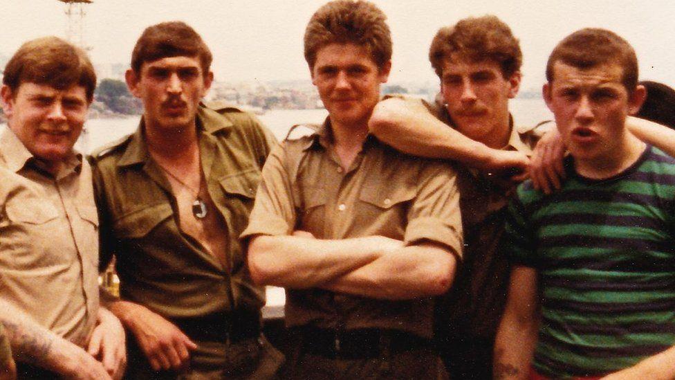 Will (centre) and Nigel (far right)