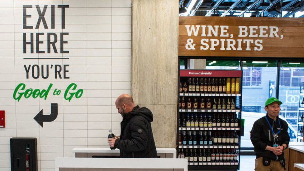 A shopper exits Amazon Go Grocery on February 26, 2020 in Seattle, Washington.