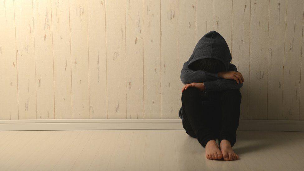 child hiding face