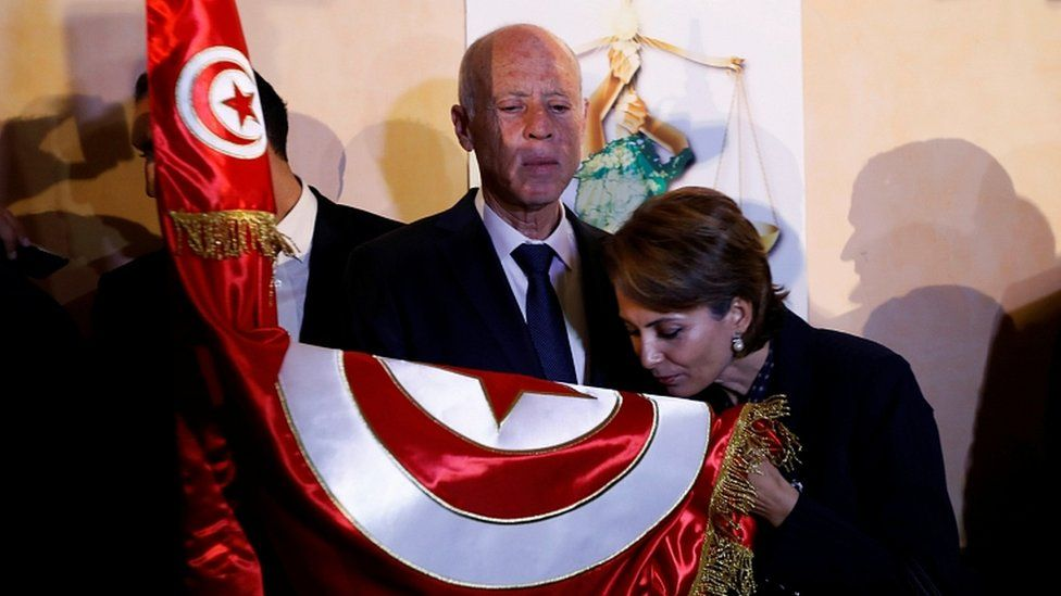 Tunisian presidential candidate Kais Saied and his wife Ichraf Chebil react after exit poll results were announced in Tunis, October 13, 2019