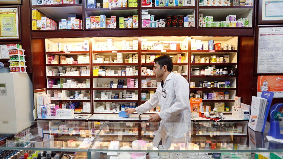 Man working at a pharmacy in Iran