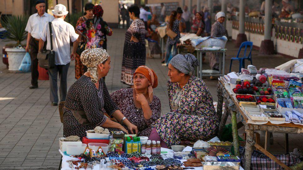 Street vendors talk at a market in Tashkent, Uzbekistan, Wednesday, Aug. 31, 2016.