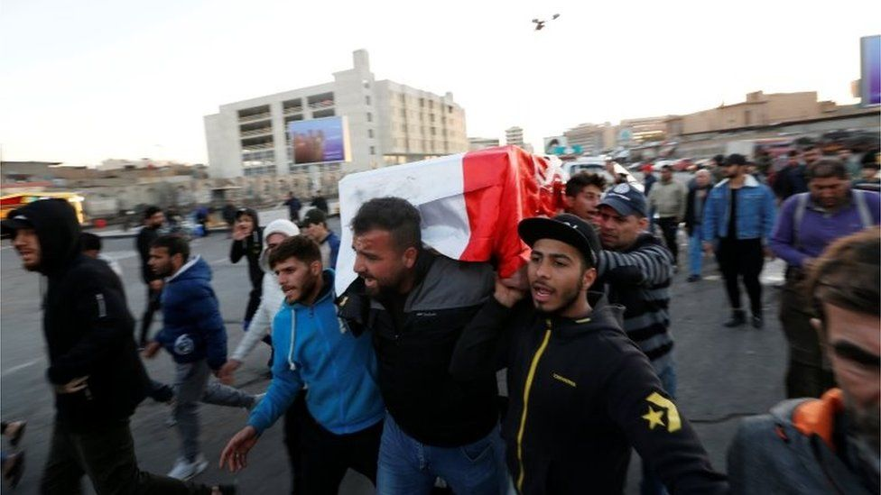 Mourners carry the coffin of a victim of a double suicide bombing at a market in Baghdad (21/01/21)