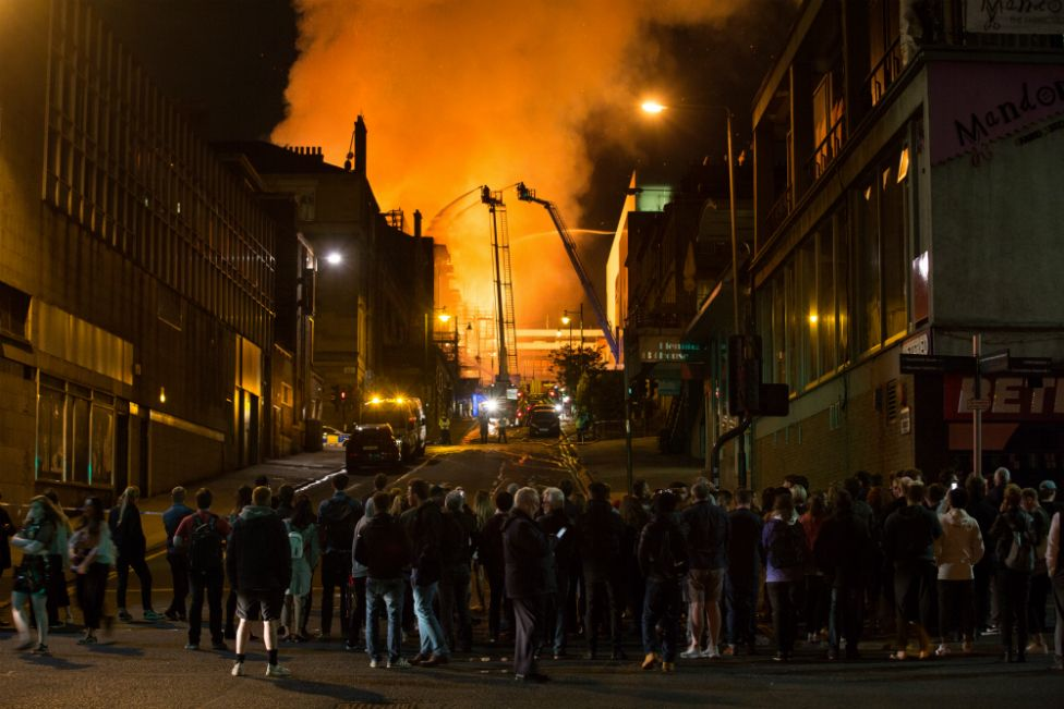Crowds look on as firefighters tackle the blaze
