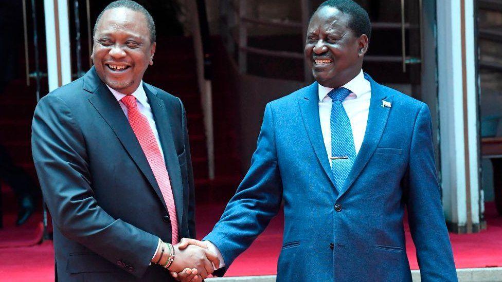 President Uhuru Kenyatta (L) shakes hands with the National Super Alliance (NASA) coalition opposition leader Raila Odinga