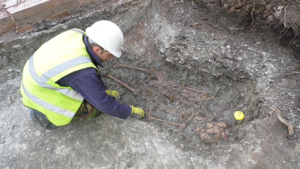An archaeologist excavates one of the skeletons in the Roman cemetery at Western Road