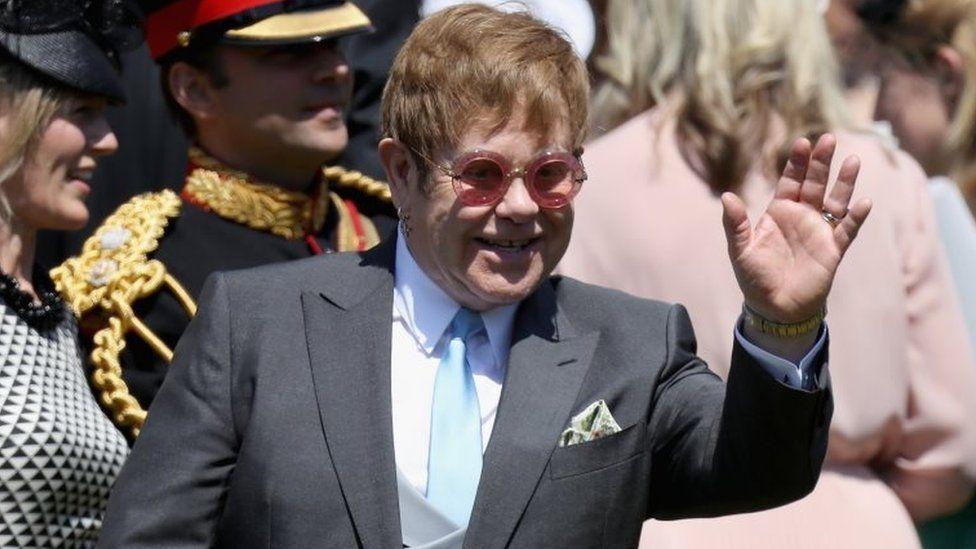Elton John waving at the crowds