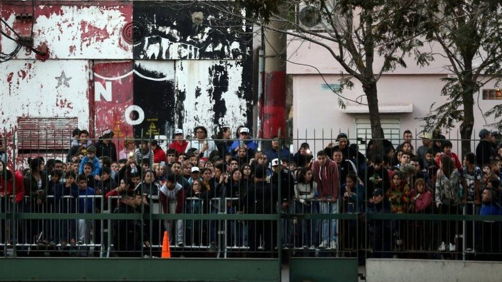 Crowds outside the hotel where Lionel Messi's wedding takes place in Rosario, Argentina. Photo: 30 June 2017