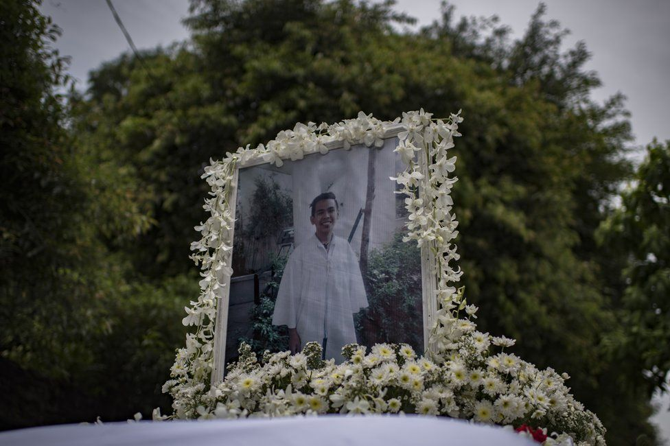 A photo of Kian Delos Santos, 17, on top of the hearse during his funeral in Caloocan city, Philippines, 26 August