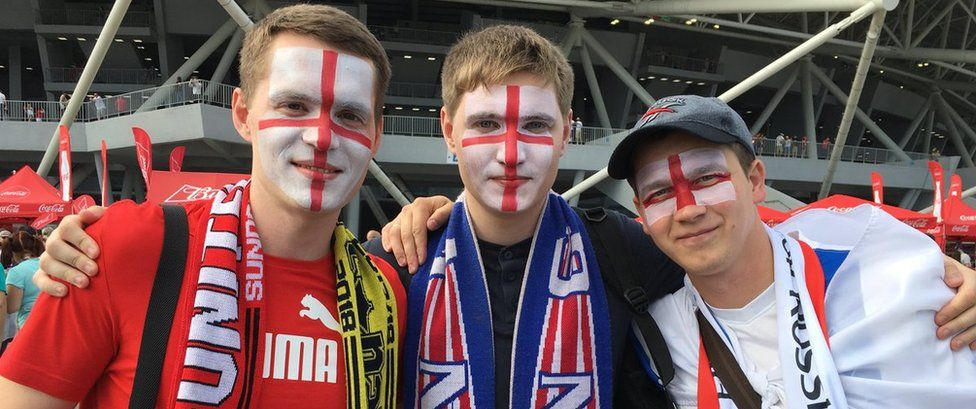 Russian fans with England flags daubed on their faces in Samara on 7 July