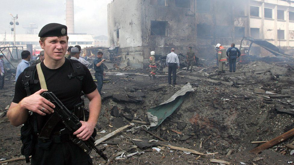 Policeman at site of attack on police compound in Ingushetia, 2010