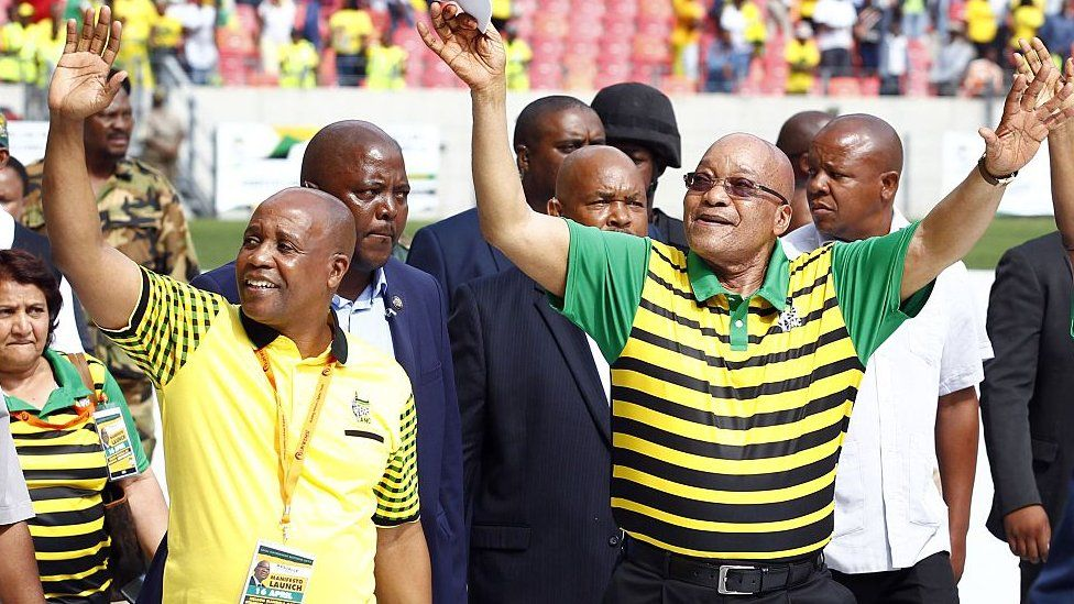 South African president and African National Congress (ANC)'s president Jacob Zuma (R) waves at supporters as he arrives for the Party official launch of the Municipal Elections manifesto on April 16, 2016 in Port Elizabeth, South Africa