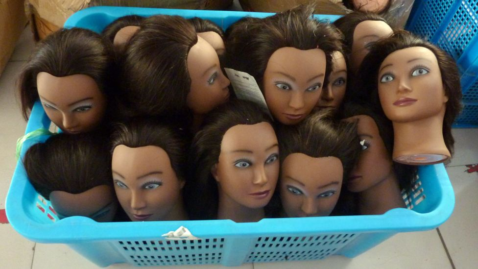 Human hair wigs at a factory in Xuchange, China