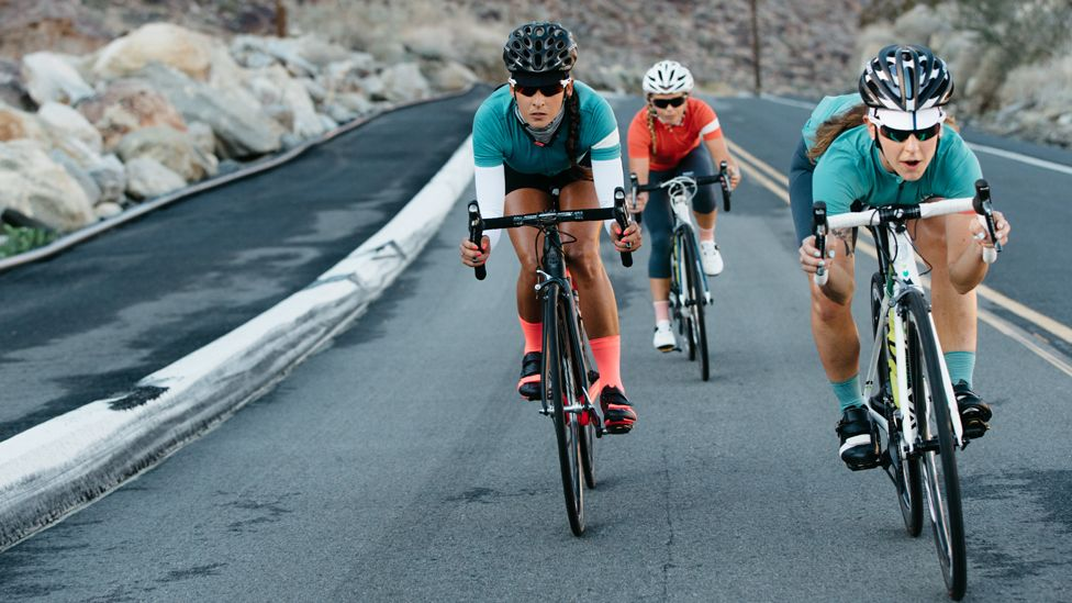 Female cyclists wearing Rapha clothing