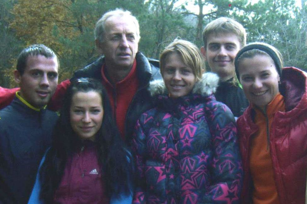 Stepanova (centre) with fellow athletes and trainer Vladimir Mokhnev