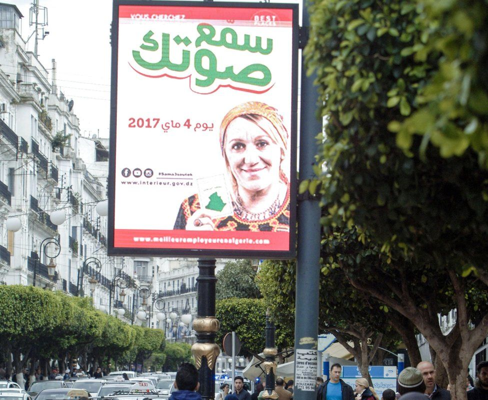 A poster in Algiers urging people to vote